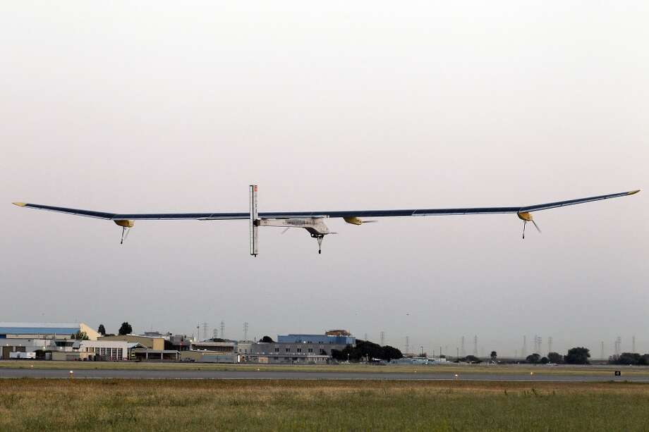 The Solar Impulse plane takes off. The plan will stop for seven to 10 days at major airports in each city, so the pilots can display and discuss the aircraft with reporters, students, engineers and aviation fans. (AP Photo/Tony Avelar) Photo: Tony Avelar, Associated Press