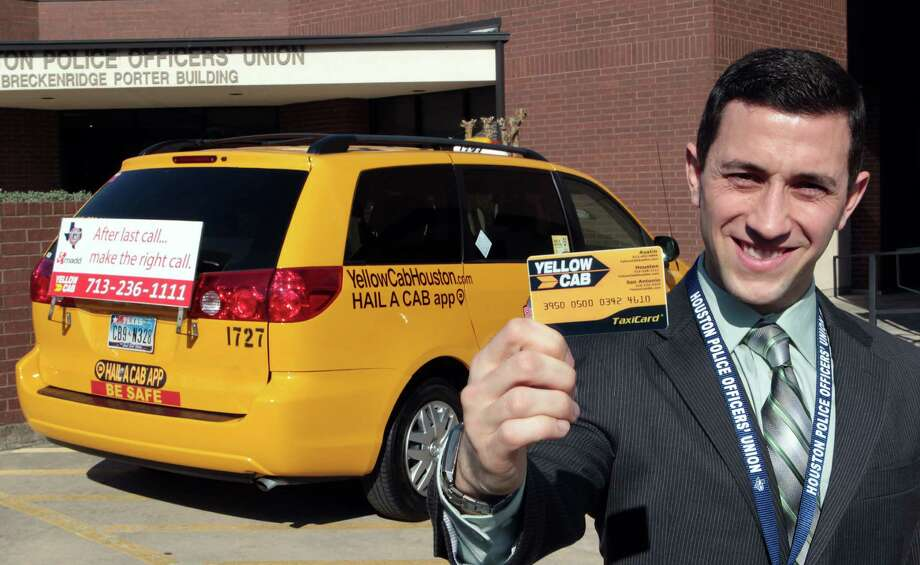 Houston Police Officers' Union Vice President Joseph Gamaldi holds a prepaid TaxiCard which is part of a program which the union will be paying for cab rides home for police officers who've had too much too drink Wednesday, Jan. 23, 2013, in Houston. The union is using interest from its investments to pay Yellow Cab to drive officers home, but they are not allowed to take officers to another bar. ( James Nielsen / Chronicle ) Photo: James Nielsen, Staff / © Houston Chronicle 2013