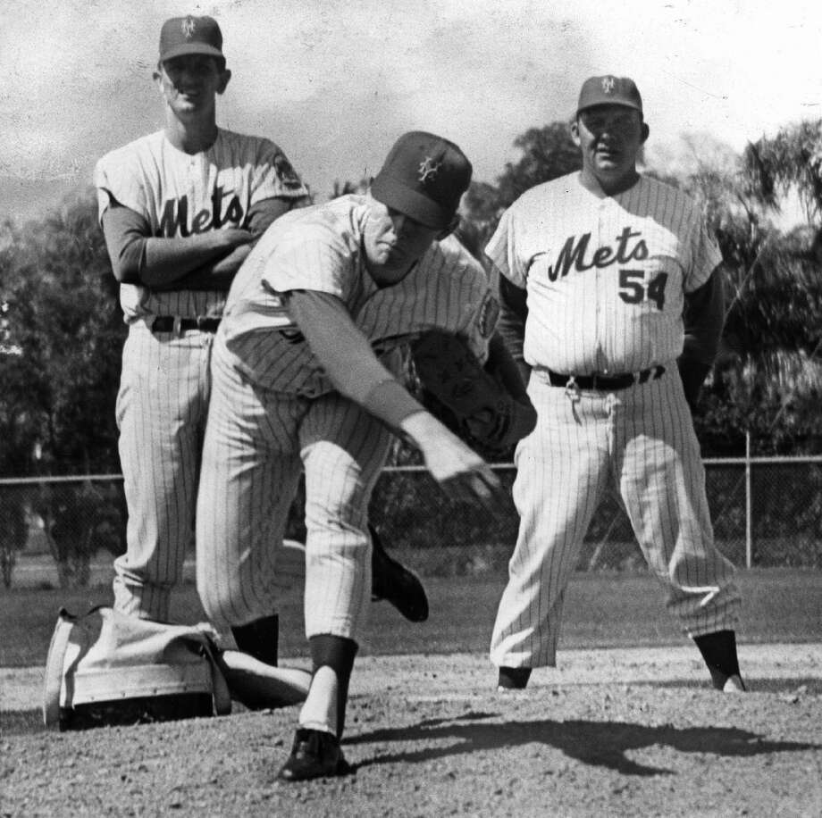 Under the eyes of New York Mets coaches Wes Stock and Rube Walker, a young Nolan Ryan displays his pitching talents in a Mets' training camp in St. Petersburg, Fla in 1968 Photo: New York Daily News Archives