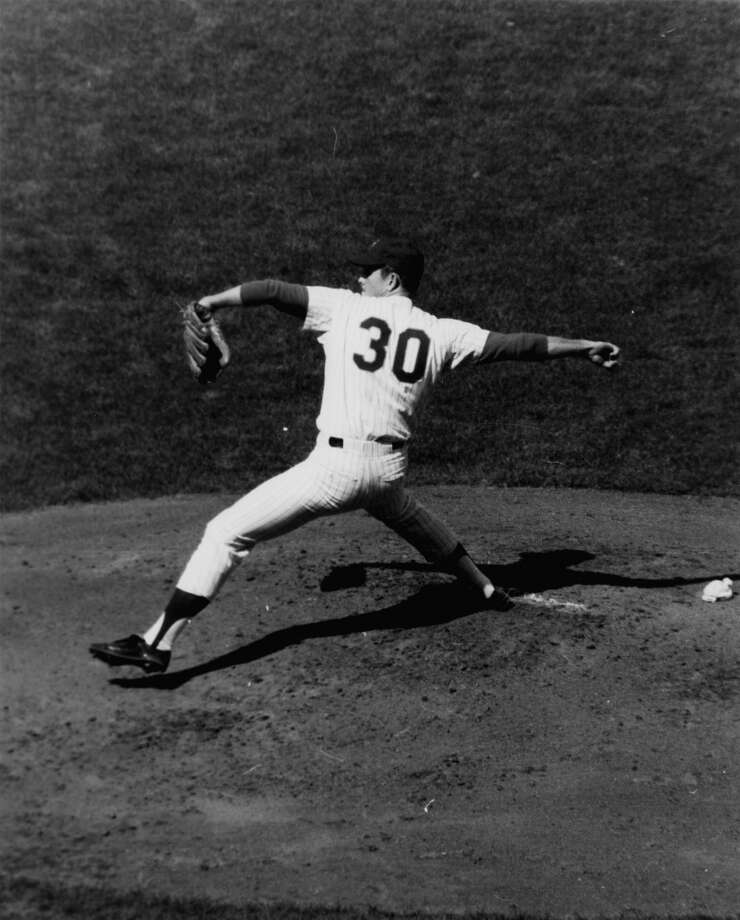 Nolan Ryan is shown during a game against Los Angeles Dodgers in New York's Shea Stadium on April 19, 1968. Ryan struck out 11 Dodgers before being relieved in the eight inning. Even at age 21, the Texas was being compared to Walter Johnson and Bob Feller. Photo: Associated Press