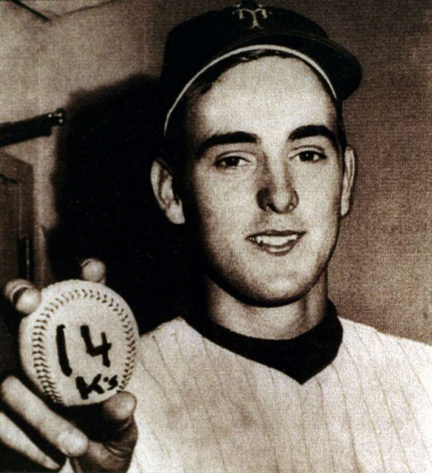 Nolan Ryan holding baseball when he set Mets team record striking out 14 Reds in 1968. Photo: Kerwin Plevka, Houston Chronicle File
