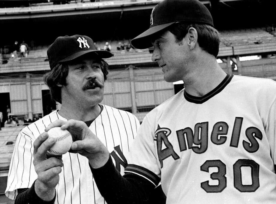 New York Yankees pitcher Jim 'Catfish' Hunter and California Angels pitcher Nolan Ryan meet before a game in New York on June 9, 1975. Photo: Associated Press