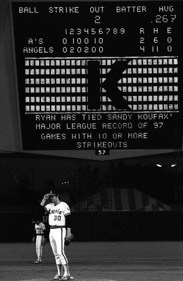 Nolan Ryan tips his cap after striking out Oakland's Marty Perez and tieing Sandy Koufax's all-time major league record in 10-plus strikeout games of 97 in Anaheim, Calif., in this July 4, 1977 file photo. Photo: Associated Press