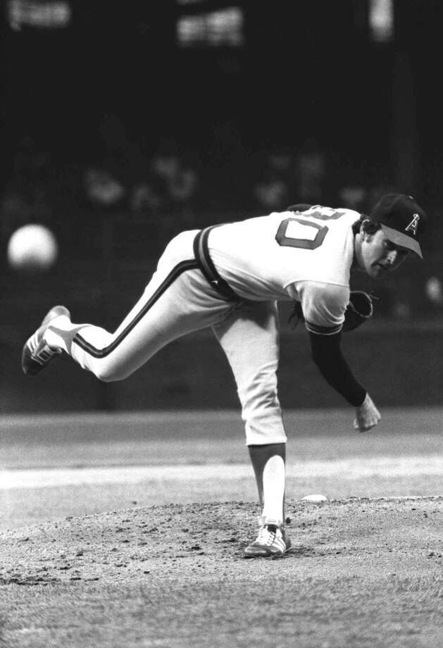 California Angels' Nolan Ryan watches his pitch as he warms up in Detroit, in this May 25, 1977 photo. Photo: Associated Press