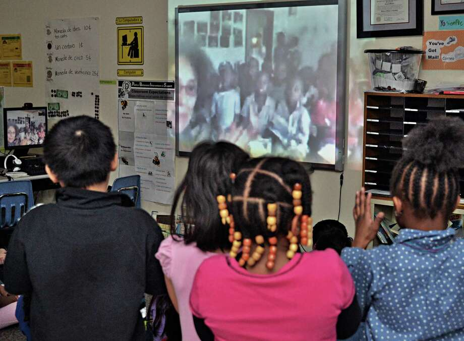 Delaware Community School 2nd graders Skype talk with Music Mobile's Ruth Pelham and students from Kampala, Uganda Tuesday, Feb. 11, 2014, in Albany, N.Y.  (John Carl D'Annibale / Times Union) Photo: John Carl D'Annibale / 00025719A
