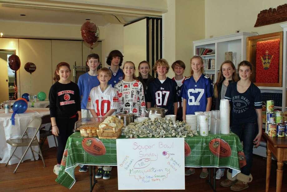 Members of the middle school youth group of First Presbyterian Church  pause before the opening of their SouperBowl of Caring Café. Photo: Contributed Photo, Contributed / New Canaan News Contributed