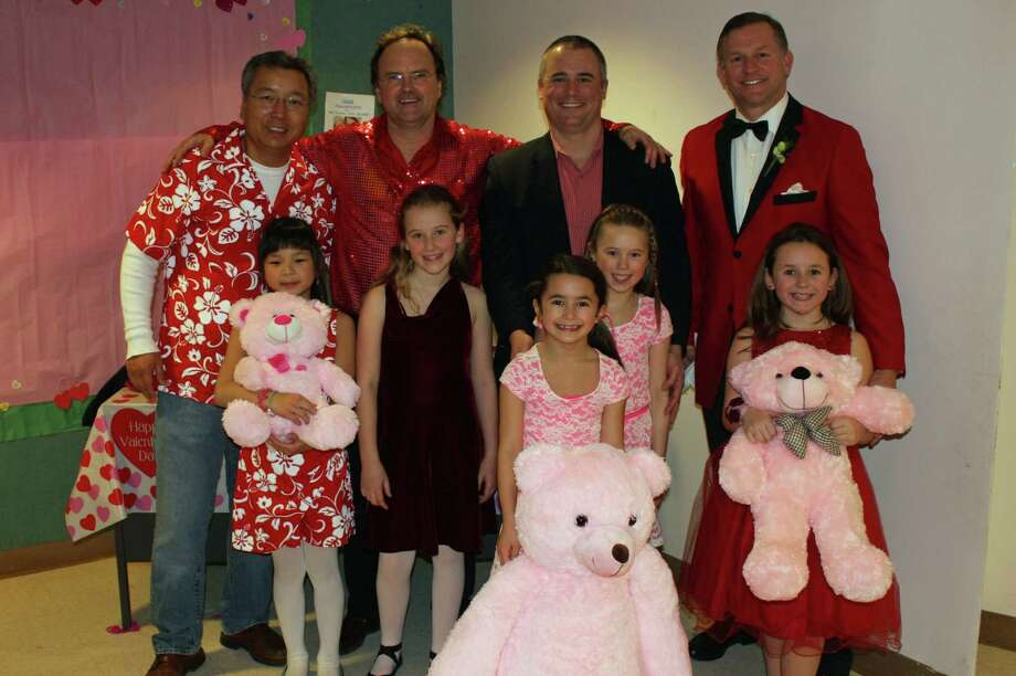 From left, Kam and Sophie Cheung; Charles and Grace Crookenden; Mark, Danielle and Addison Sedlak; and Matthew and Sophie Youngs at the Valentine Daddy/Daughter Dance at East School Saturday, Feb. 8. Photo: Contributed Photo, Contributed / New Canaan News Contributed
