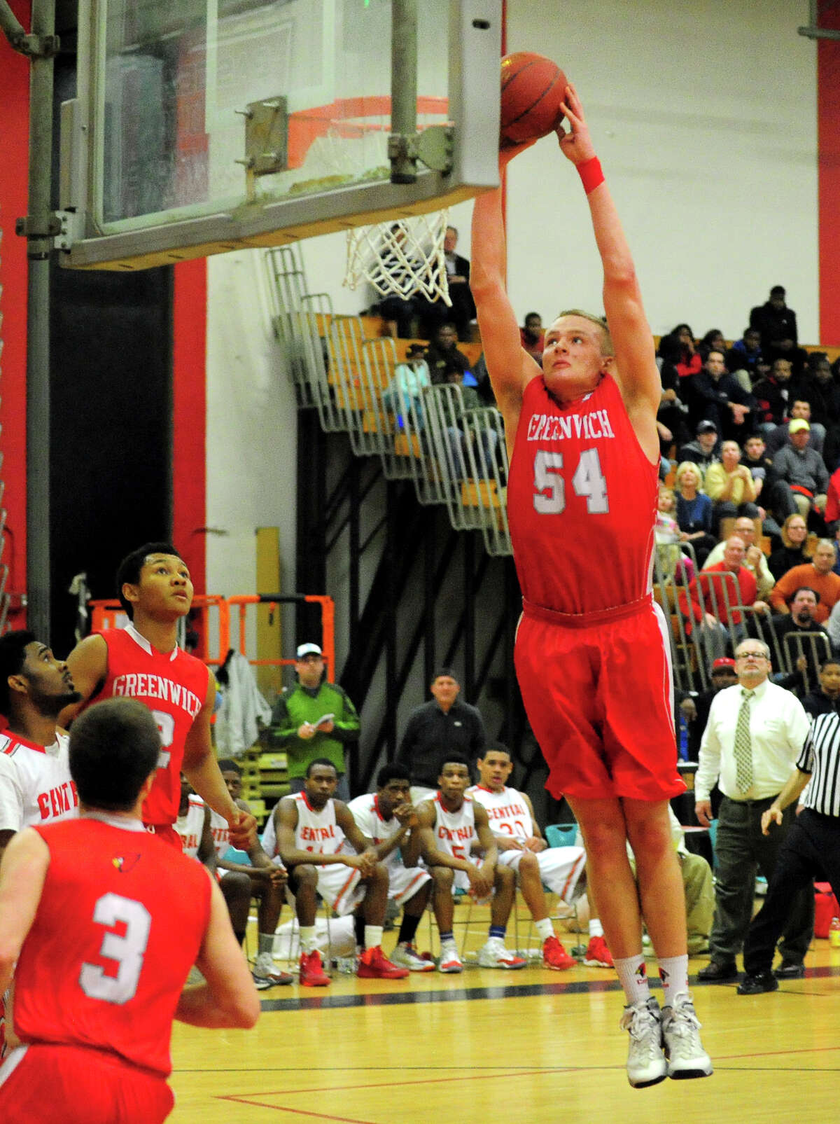 Greenwich's Alex Wolf prepares to slam dunk the ball, during boys basketball action against Central in Bridgeport, Conn. on Tuesday February 11, 2014.