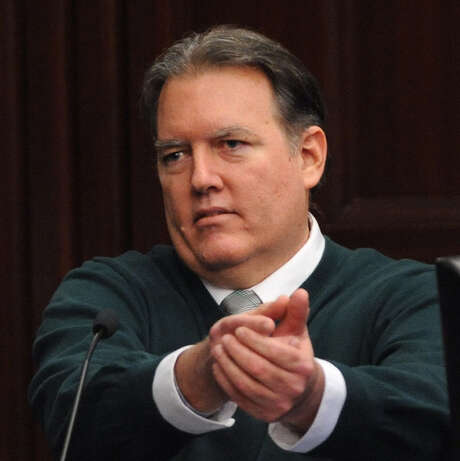 Michael Dunn gestures on the stand in his defense during his murder trial in Jacksonville, Fla. Photo: Bob Mack / Florida Times-Union / Pool, The Florida Times-Union