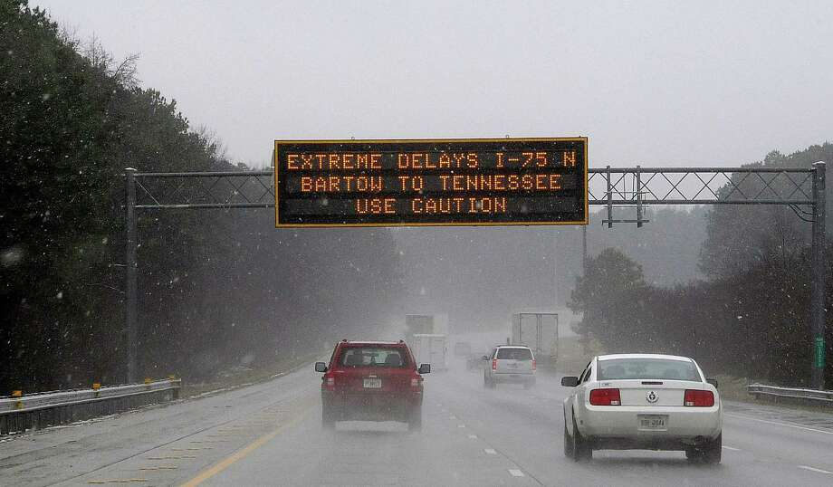 "A sign warns motorists of potentially dangerous conditions on Interstate 75 in Ken- nesaw, Ga., about 20 miles north of Atlanta. Ice ""is our biggest enemy,"" Gov. Nathan Deal said. Photo: David Tulis / Associated Press / FR170493 AP"