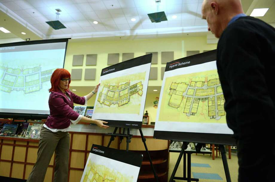Julia McFadden and Barry Svigals, of Svigals and Partners architects, unveil plans for the new Sandy Hook Elementary School during a meeting at Reed Intermediate School in Newtown, Conn. Tuesday, Feb. 11, 2014.  The architects presented two different plans and a hybrid of the two plans to members of the Newtown Board of Education and Public Building and Site Committee. Photo: Tyler Sizemore / The News-Times