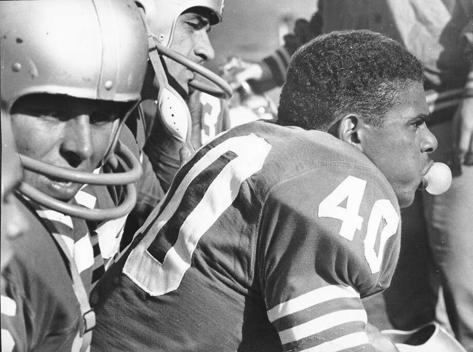 Abe Woodson (40) relaxes during the 49ers' 34-0 win over the Rams in 1959, when he led the NFL in kickoff- return yardage. Photo: Barney Peterson, The Chronicle