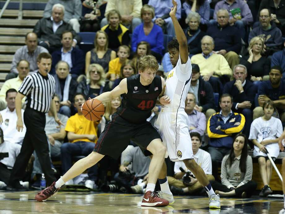 Stanford forward John Gage (left) drives against Cal guard Tyrone Wallace in the Cardinal's victory last week at Haas Pavilion. Photo: Kelley L Cox, Reuters