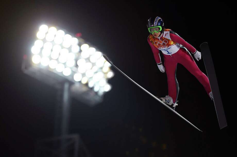 Sarah Hendrickson of the United States competes in the finals of the normal hill individual competition at the RusSki Gorki Jumping Center in Krasnaya Polyana, Russia, Feb. 11, 2014. Hendrickson finished 21st, while Germany's Carina Vogt took gold, the first ever awarded to a woman in ski jumping in Winter Olympics history. (James Hill/The New York Times) -- NO SALES. ORG XMIT: XNYT159 Photo: JAMES HILL / NYTNS