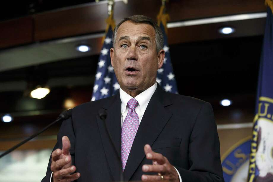 House Speaker John Boehner, R-Ohio, said Tuesday the House would vote to increase the government's borrowing cap without trying to attach conditions sought by some Republicans. Photo: Scott Applewhite / Associated Press / AP
