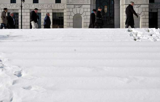 Snow covered steps in West Capitol Park as people make their way along Swan St.  on Tuesday, Feb. 11, 2014 in Albany, NY.      (Paul Buckowski / Times Union) Photo: Paul Buckowski