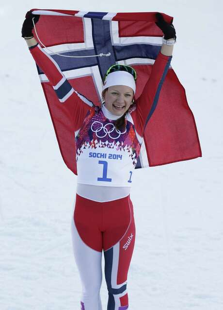 Norway's Maiken Caspersen Falla waves her country's flag after winning the gold medal in the women's cross country freestyle sprint. Photo: Matthias Schrader / Associated Press / AP