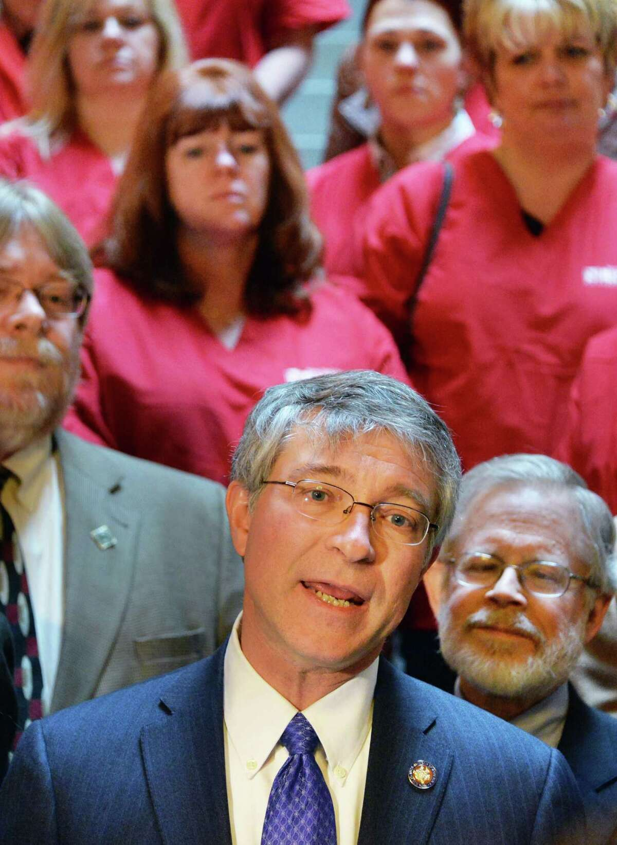 """Assemblyman Phil Steck speaks during a rally in support of """"New York Health"""" Tuesday Feb. 11, 2014, at the Capitol in Albany, NY. At right is Assembly Health Committee Chair Richard N. Gottfried. (John Carl D'Annibale / Times Union)"""