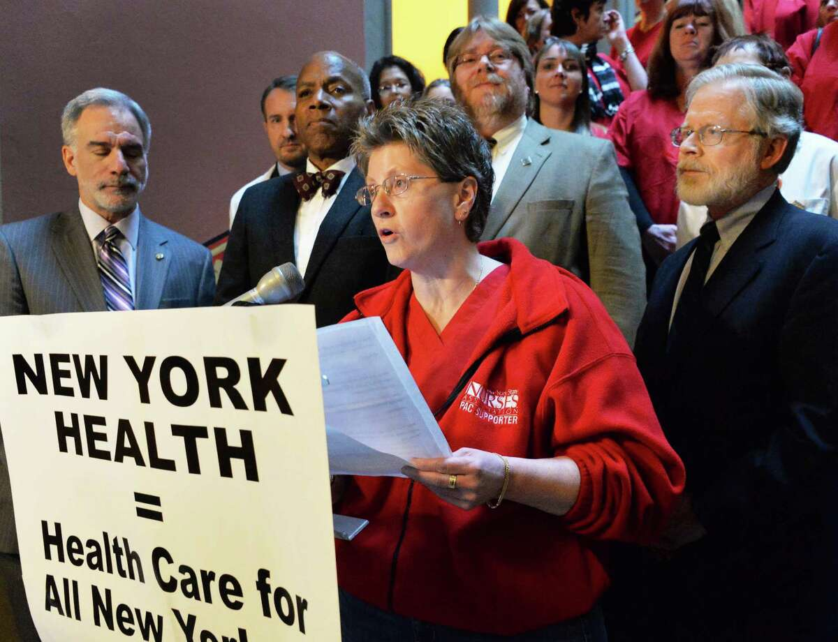 """Lisa Blodgett, an RN for Ellis Health Care, speaks during a rally in support of """"New York Health"""" Tuesday Feb. 11, 2014, at the Capitol in Albany, NY. At right is Assembly Health Committee Chair Richard N. Gottfried. (John Carl D'Annibale / Times Union)"""