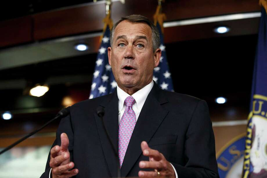 """FILE - In this Feb. 6, 2014 file photo, House Speaker John Boehner of Ohio speaks during a news conference on Capitol Hill in Washington. In a concession to President Barack Obama and Democratic lawmakers, Boehner said Tuesday the House will vote to increase the government's borrowing cap without trying to attach conditions sought by some Republicans. """"We'll let his party give him the debt ceiling increase that he wants,"""" Boehner said, hours before the expected evening vote.  (AP Photo/J. Scott Applewhite, File) ORG XMIT: WX109 Photo: J. Scott Applewhite / AP"""
