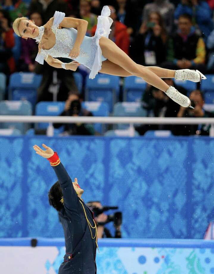 Tatiana Volosozhar and Maxim Trankov of Russia compete in the pairs short program figure skating competition at the Iceberg Skating Palace during the 2014 Winter Olympics, Tuesday, Feb. 11, 2014, in Sochi, Russia. (AP Photo/Vadim Ghirda) ORG XMIT: OLYFS442 Photo: Vadim Ghirda / AP