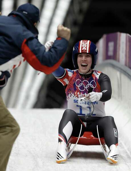 """American Erin Hamlin — who said she had """"no expectations"""" going into the luge — was all smiles after her bronze-medal run in Krasnaya Polyana. Germany's Natalie Geisenberger won. Photo: Dita Alangkara / Associated Press / AP"""