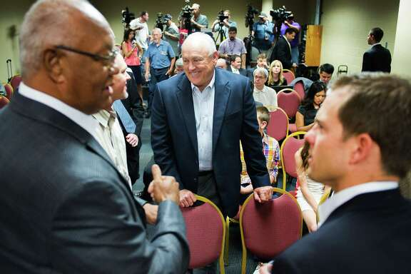 After setting records of 5,714 strikeouts and seven no-hitters in 27 seasons in a major league uniform, Nolan Ryan, center, proved himself just as adept in a CEO's suit, helping the Texas Rangers reach the World Series in 2010 and 2011.