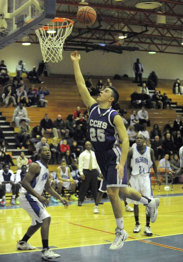 Catholic Central's Anthony Mack goes in for a score during their high school boy's basketball game against Albany High on Tuesday Feb. 11, 2014 in Albany, N.Y. (Michael P. Farrell/Times Union) Photo: Michael P. Farrell / 00025710A