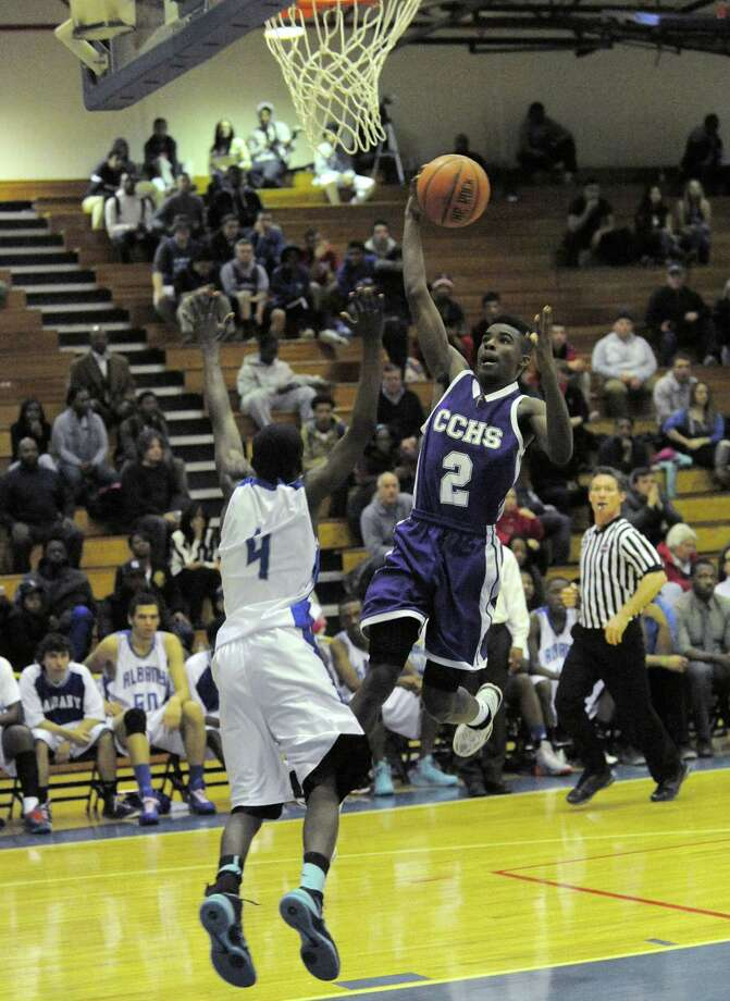 Catholic Central's Raiquis Harris goes in for a score during their high school boy's basketball game against Albany High on Tuesday Feb. 11, 2014 in Albany, N.Y. (Michael P. Farrell/Times Union) Photo: Michael P. Farrell / 00025710A