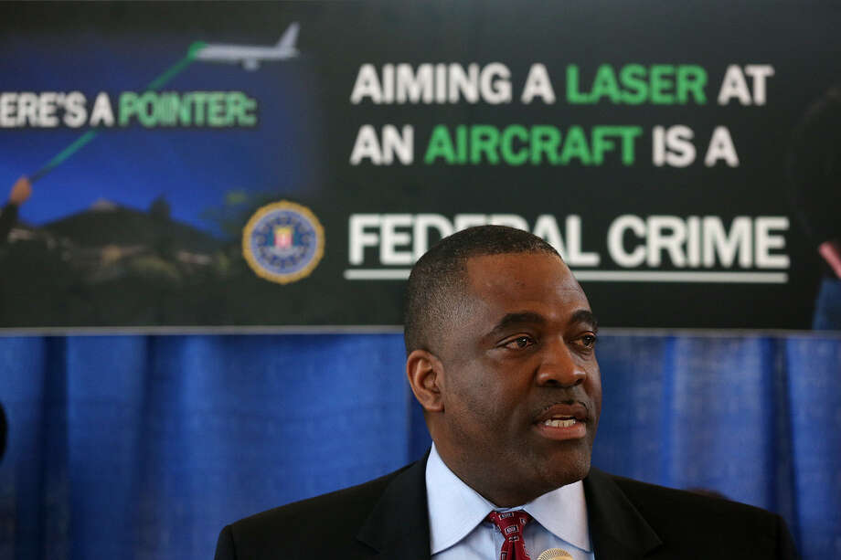 Calvin A. Shivers, assistant special agent in charge of the FBI in San Antonio, talks about the serious threat laser strikes pose to pilots, aircraft and the public while announcing a 60-day incentive to report people who point lasers at aircraft. Photo: Jerry Lara / San Antonio Express-News / © 2014 San Antonio Express-News