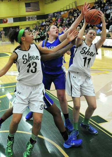Shenendehowa's Sydney Brown, #13, and Morgan O'Brien, #11, try to keep the rebound from Shaker's Sag