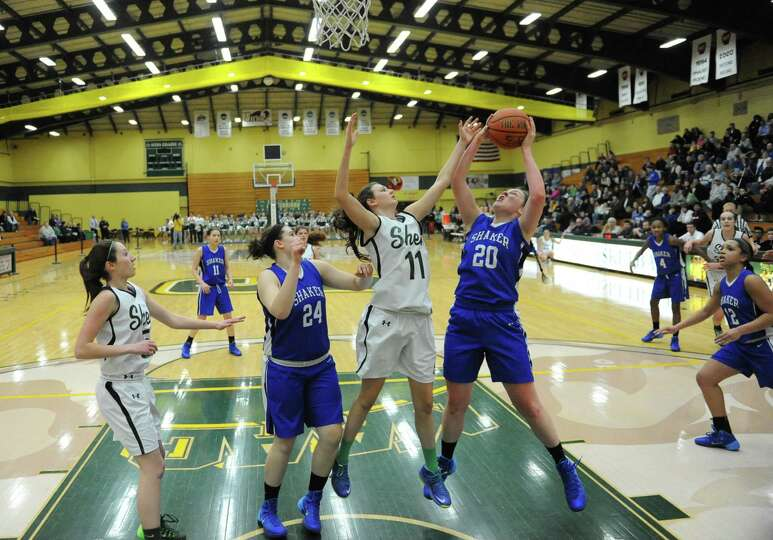 Shenendehowa's Morgan O'Brien, #11, and Shaker's Sage VanAmerongen, #20, battle for a rebound during