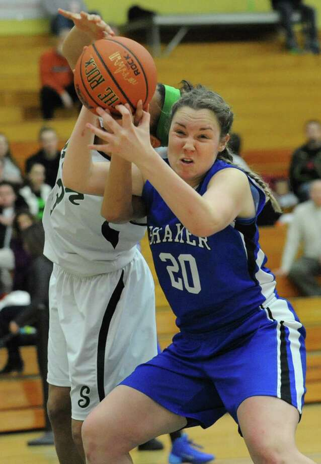 Shenendehowa's Sydney Brown battles for a rebound with Shaker's Sage VanAmerongen during a basketball game at Siena College on Tuesday, Feb. 11, 2014 in Loudonville, N.Y.  (Lori Van Buren / Times Union) Photo: Lori Van Buren / 00025711A