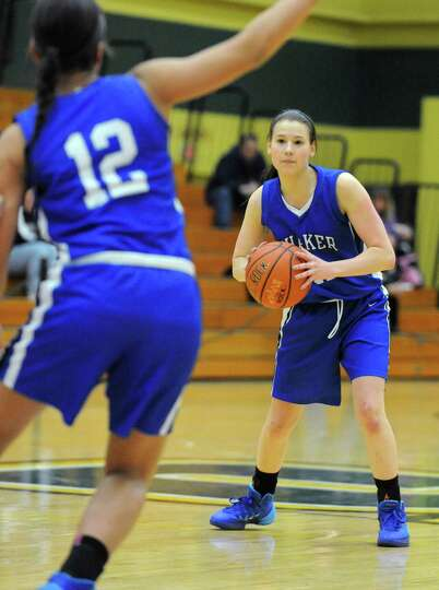Shaker's Jenni Barra looks to pass the ball to Merrick Rowland, #12, during a basketball game agains