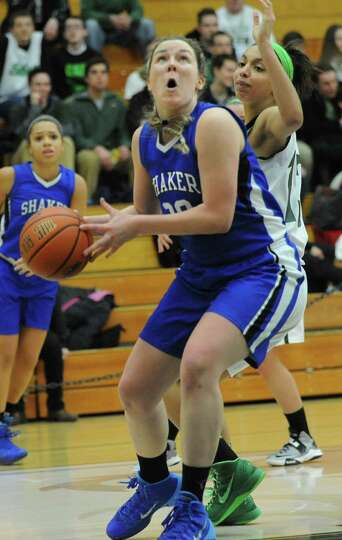 Shaker's Sage VanAmerongen drives to the hoop during a basketball game against Shenendehowa at Siena