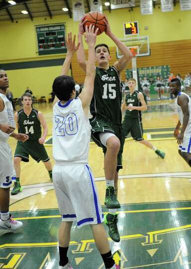 Shenendehowa's Thomas Huerter is guard by Shaker's Justin Brehm as he drives down the middle of the