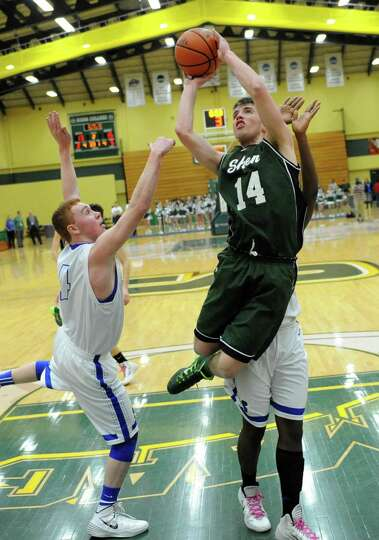 Shenendehowa's Troy Farkas is fouled as he goes up for a shot guarded by Shaker's Andrew Holmes duri