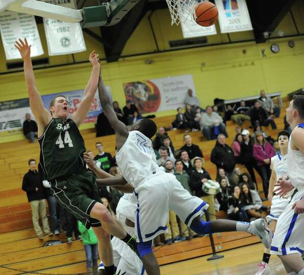 Shenendehowa's Brendon Fischer is fouled by Shaker's Brian Mawejje during a basketball game at Siena