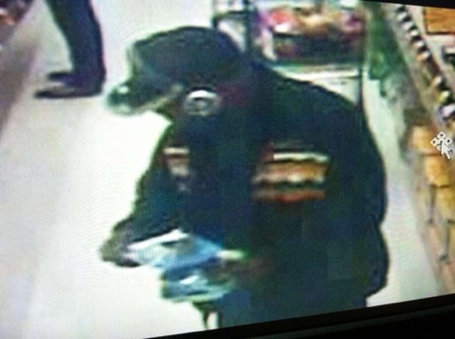 Surveillance footage of the suspect that witnesses reported jumping into  an SUV outside a Safeway store in Oakland, before the vehicle drove off  with an elderly man and a 13-year-old girl inside, police said. Photo: California Highway Patrol