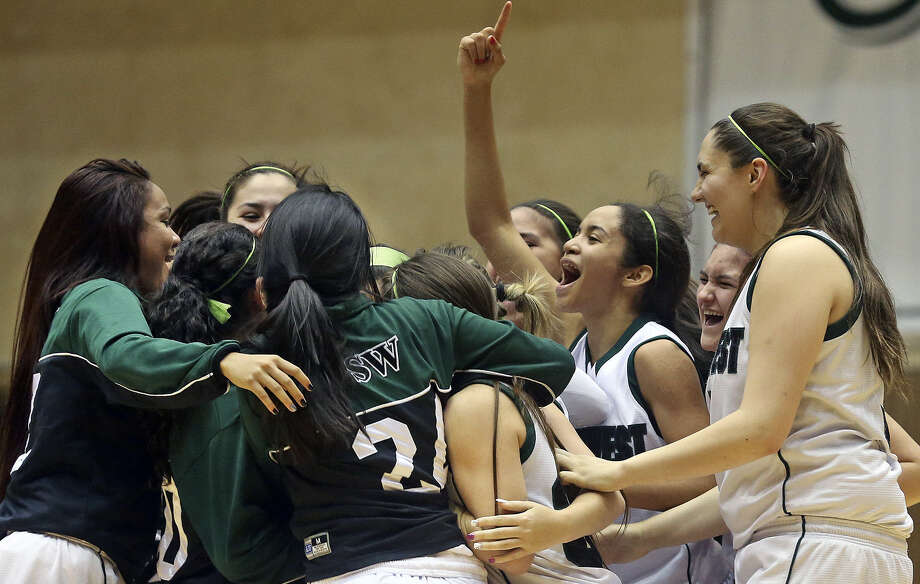 The Southwest girls congratulate each other after a 66-56 upset over No. 8 O'Connor in the first game of a bidistrict doubleheader Tuesday at UTSA's Convocation Center. Photo: Tom Reel / San Antonio Express-News
