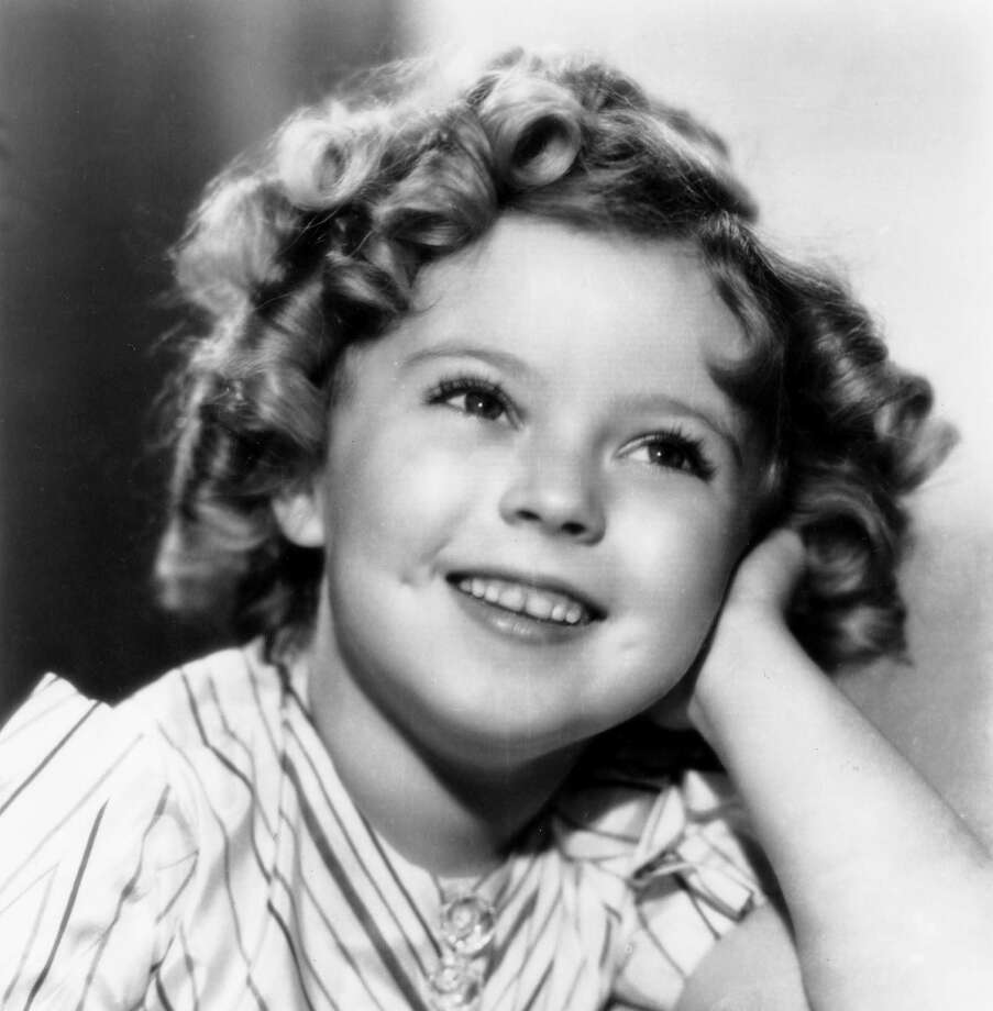 Shirley Temple made 23 films during the Depression, lifting moviegoers' spirits with her infectiously sunny personality. Photo: Globe Photos / McClatchy-Tribune News Service / Zuma Press