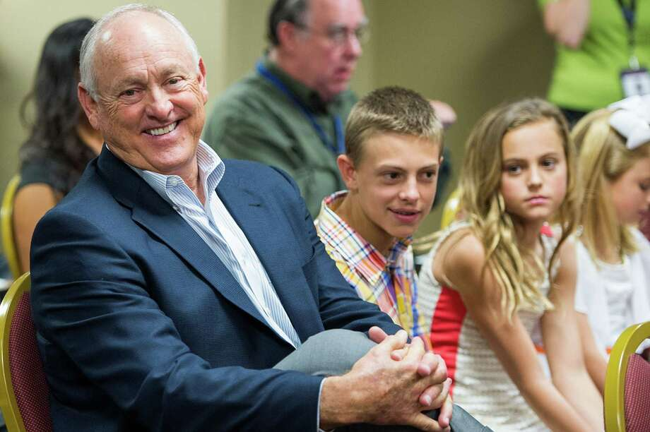 Nolan Ryan joined his grandchildren when son Reid was introduced as the Astros' president in May. Eight months later, it's more of a family affair at Minute Maid Park as the elder Ryan has agreed to join the organization. Photo: Smiley N. Pool / © 2013  Smiley N. Pool