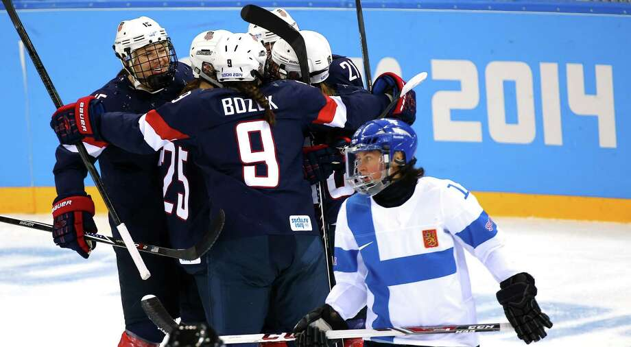 Hockey is one of the few Winter Olympic sports that is legit and not ruined by judges or marketing. Judge for yourself when the Team USA women (left) play rival Canada today. Photo: Martin Rose / Getty Images / 2014 Getty Images