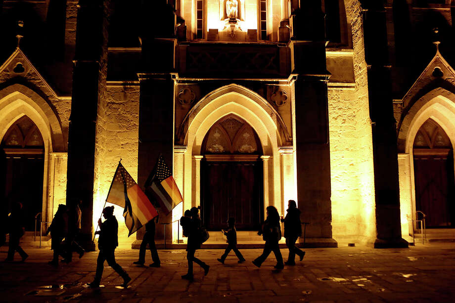 "Supporters of marriage equality walk by San Fernando Cathedral during the ""Light The Path to Marriage Equality"" march from Milam Park to the Bexar County Courthouse in San Antonio on Tuesday, Feb. 11, 2014. Photo: Lisa Krantz / San Antonio Express-News"