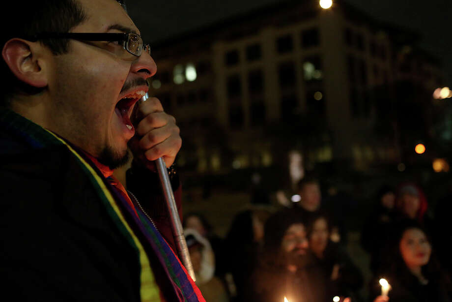 "Supporters of marriage equality including Julius Lorenzi, left, chant during the  ""Light The Path to Marriage Equality"" candlelight vigil outside the Bexar County Courthouse in San Antonio on Tuesday, Feb. 11, 2014. Photo: Lisa Krantz / San Antonio Express-News"