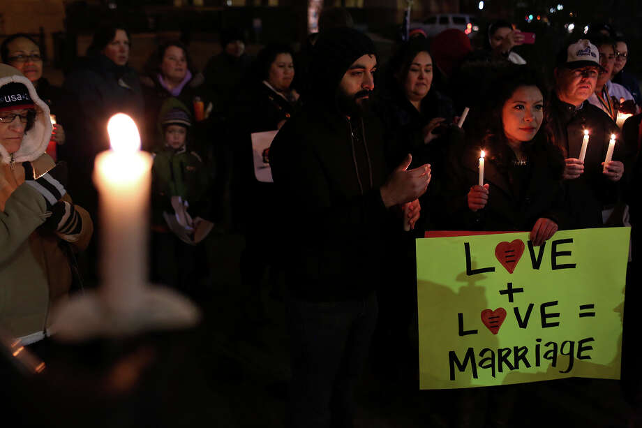 "Supporters of marriage equality including Werner Mendizabal and Mayra Alexandra, right, participate in the ""Light The Path to Marriage Equality"" candlelight vigil outside the Bexar County Courthouse in San Antonio on Tuesday, Feb. 11, 2014. Photo: Lisa Krantz / San Antonio Express-News"
