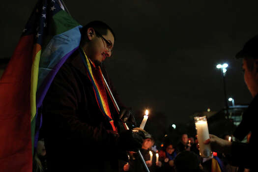 "Supporters of marriage equality including Julius Lorenzi, left, participate in the ""Light The Path to Marriage Equality"" candlelight vigil outside the Bexar County Courthouse in San Antonio on Tuesday, Feb. 11, 2014. Photo: Lisa Krantz / San Antonio Express-News"