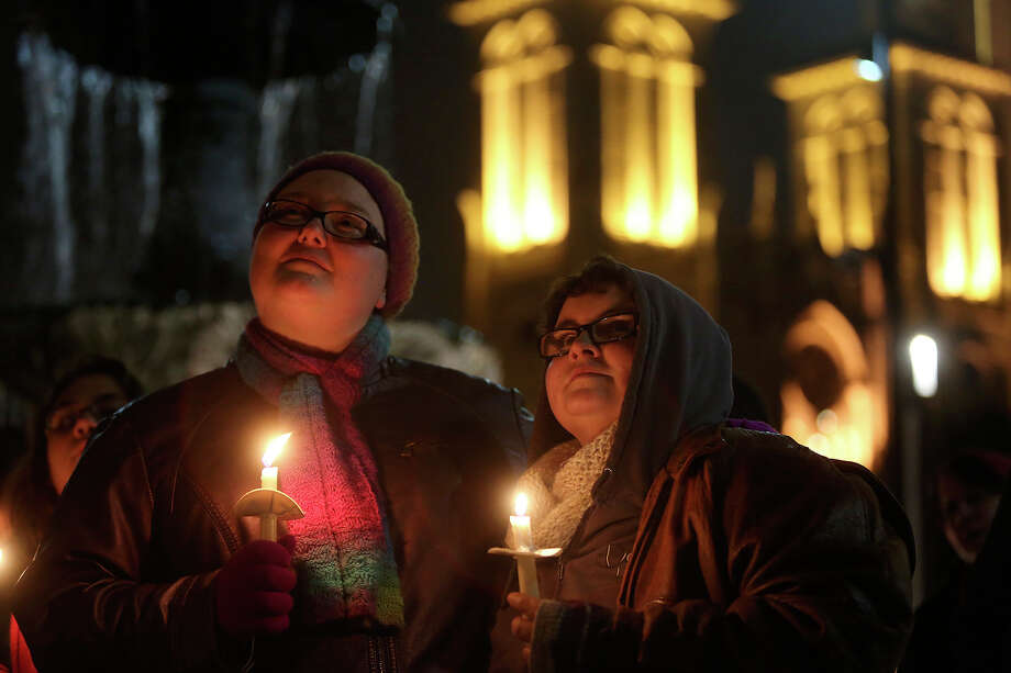 "Eliza McAdams, left, and Christina Parker attend the ""Light The Path to Marriage Equality""  candlelight vigil outside the Bexar County Courthouse in San Antonio on Tuesday, Feb. 11, 2014. Supporters of marriage equality marched from Milam Park to the courthouse during the event organized by GetEQUAL Texas. McAdams and Parker are engaged to be married and are planning their wedding for next year in Corpus Christi. Photo: Lisa Krantz / San Antonio Express-News"