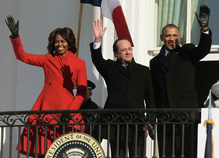 The Obamas flank French President Francois Hollande during a welcoming ceremony at the White House. Photo: Mark Wilson / Getty Images / 2014 Getty Images