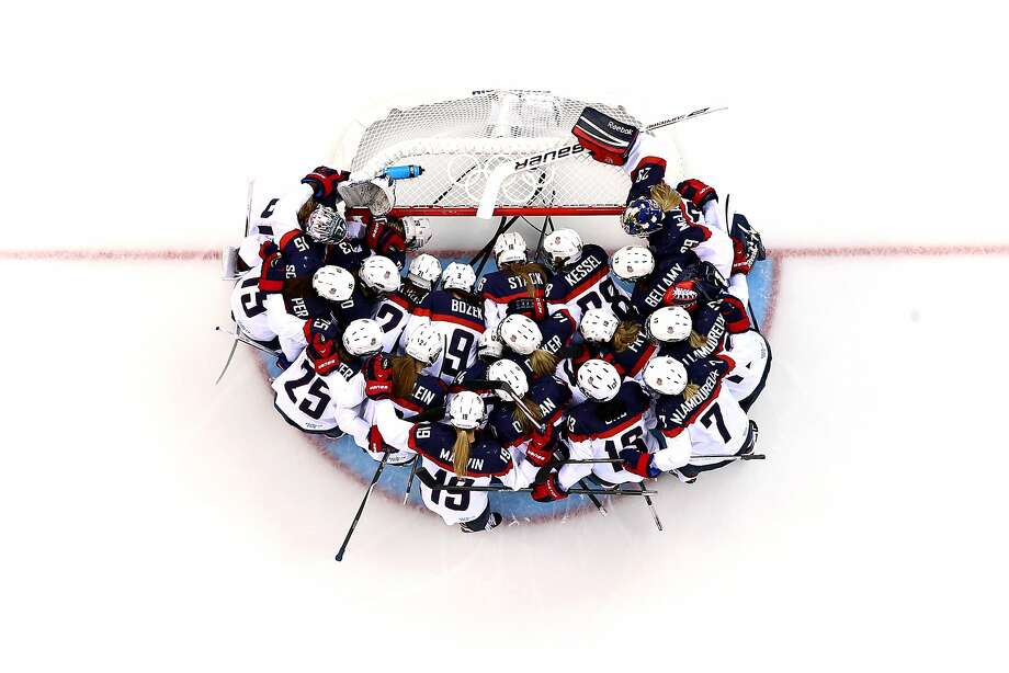 The United States team huddles around the net prior to the Women's Ice Hockey Preliminary Round Group A game against the Canada on day five of the Sochi 2014 Winter Olympics at Shayba Arena on February 12, 2014 in Sochi, Russia. Photo: Martin Rose, Getty Images